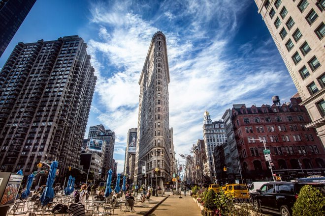 The iconic Flatiron Building gives the name of this Manhattan neighborhood